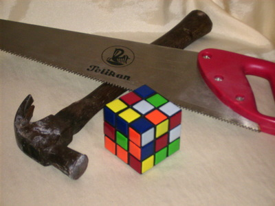 You should use the proper tools when dimantling a rubik's cube.