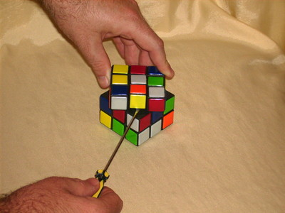 You need a screwriver to dismantle a rubik's cube